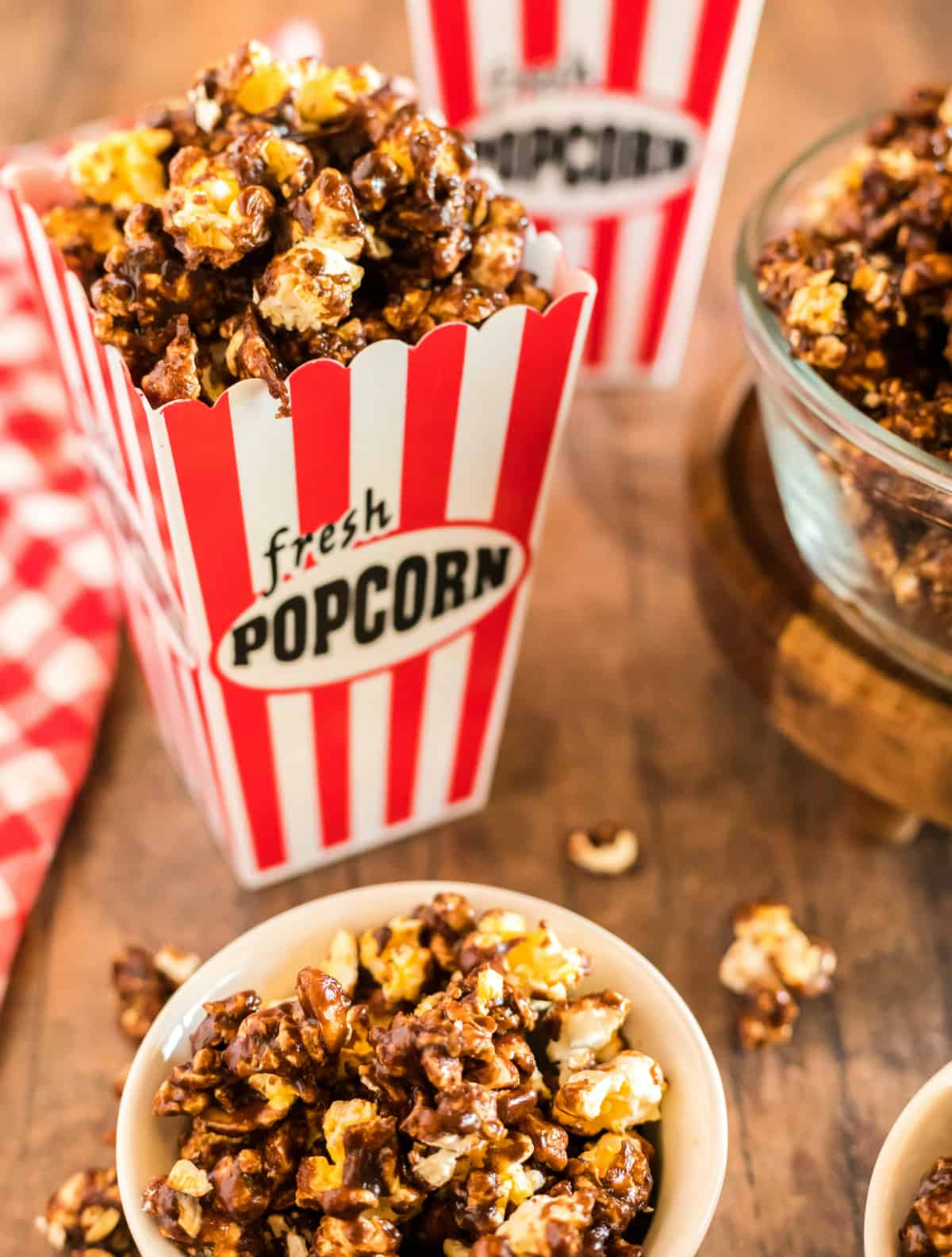 Chocolate popcorn in bowl and popcorn container