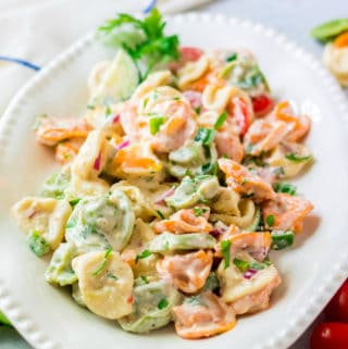 Tortellini Salad on platter garnished with parsley