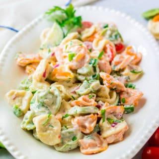 Tortellini Salad on platter garnished with parsley