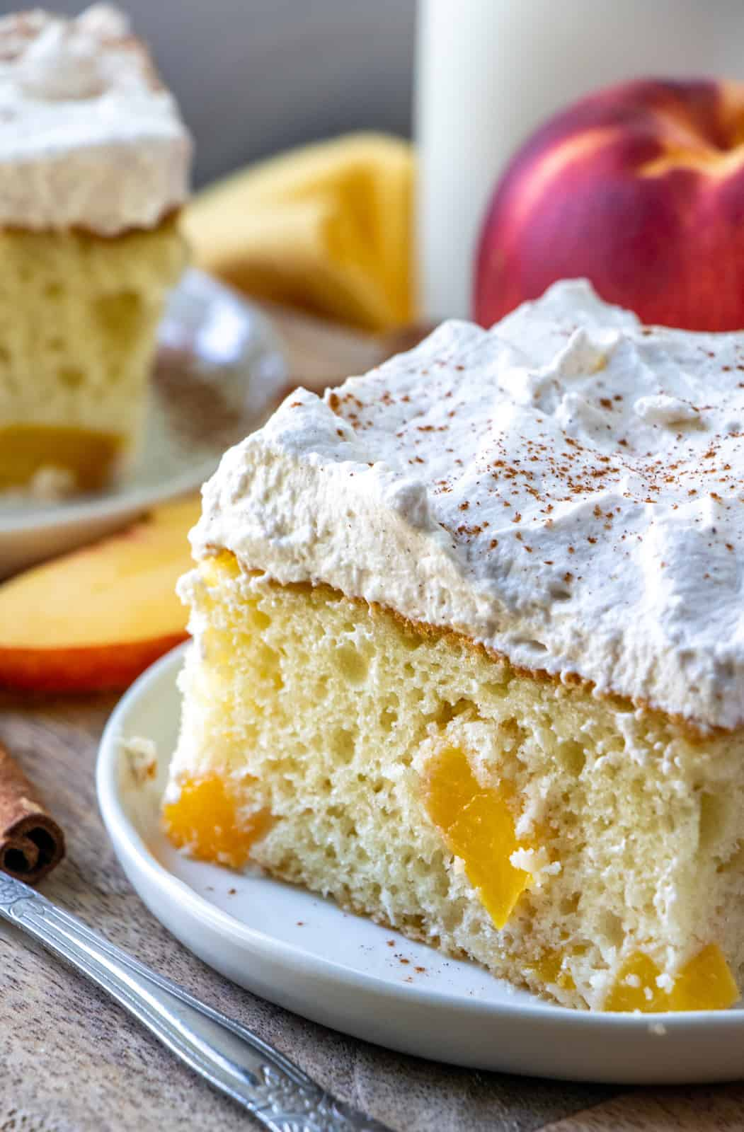 Close up of peach cake showing peaches baked in