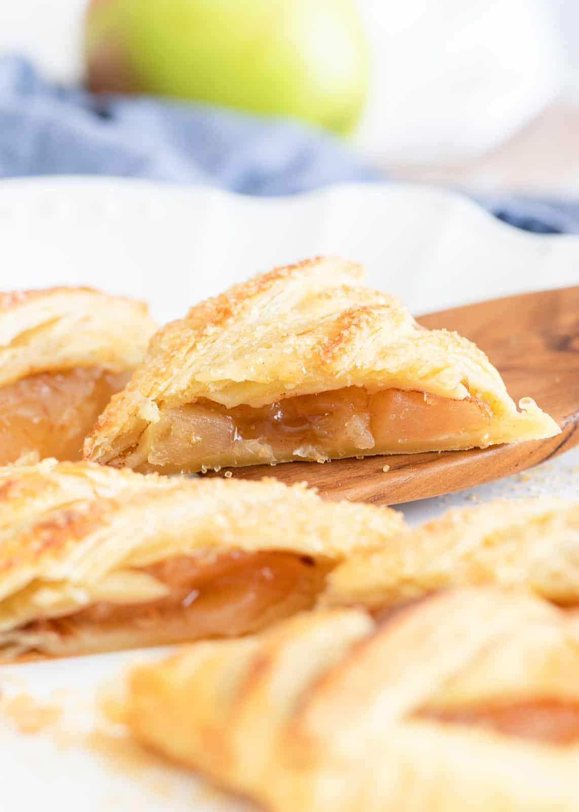 Sliced up Puff Pasty with spatula stopping one up