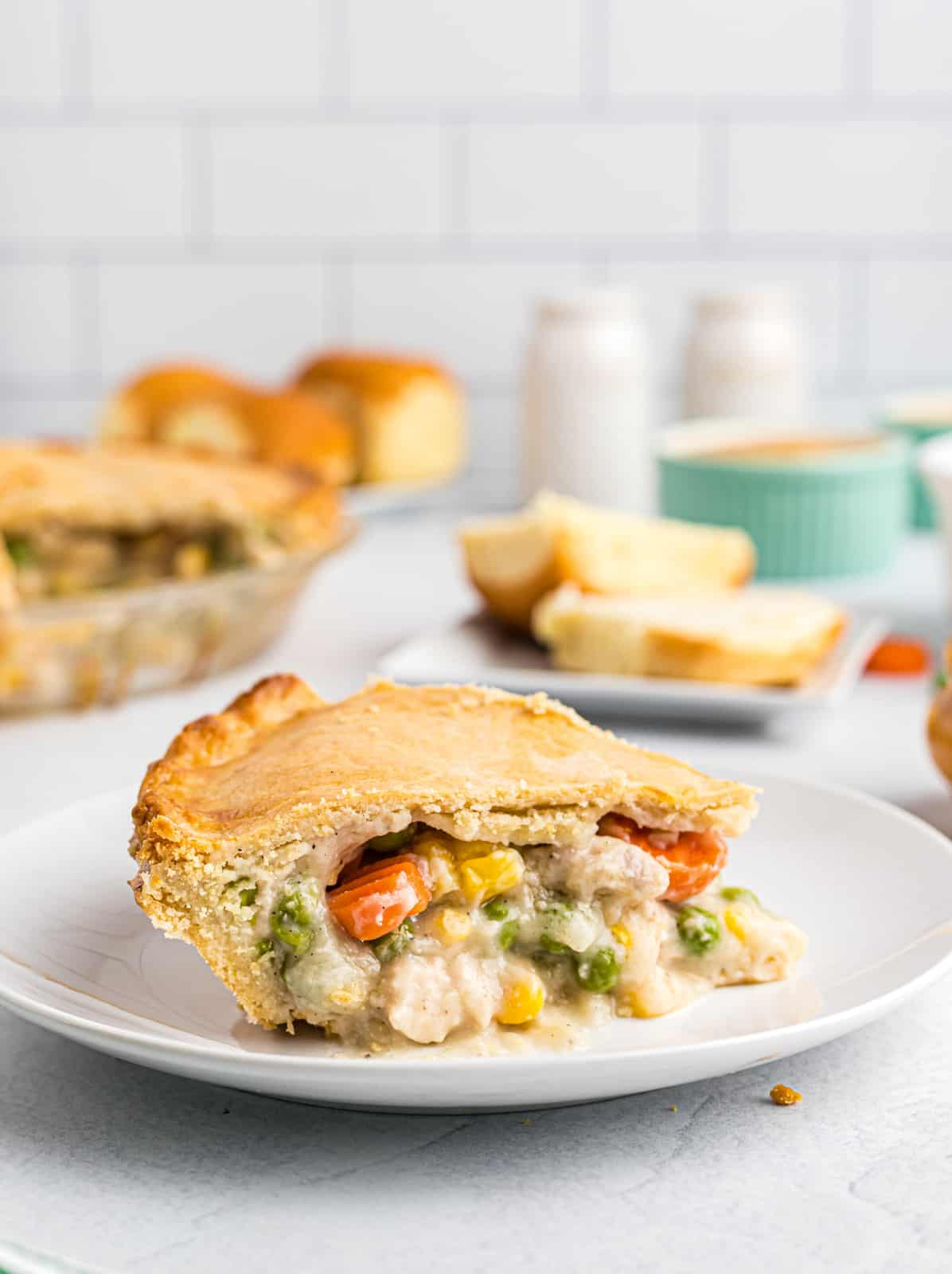Slice of Homemade Chicken Pot Pie on white plate