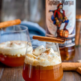 Close up of Hot Buttered Rum in glasses with captain Morgan bottle in background