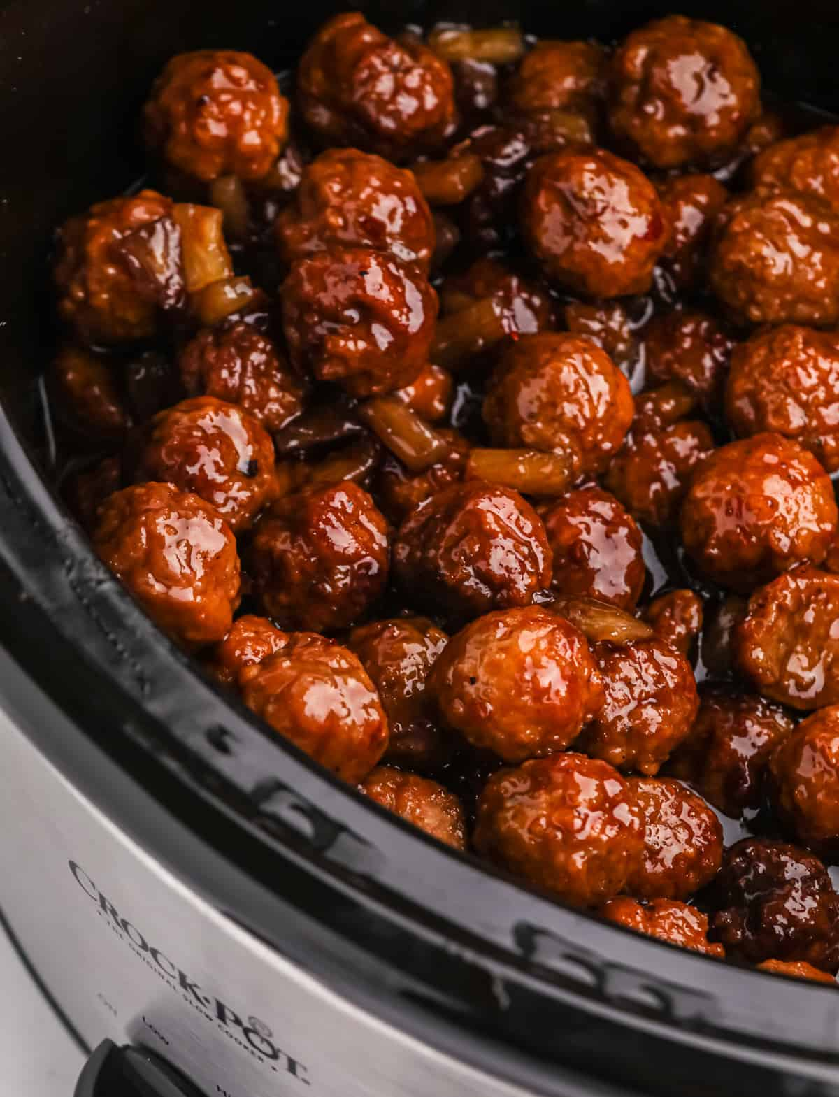 Close up of finished meatballs in slow cooker