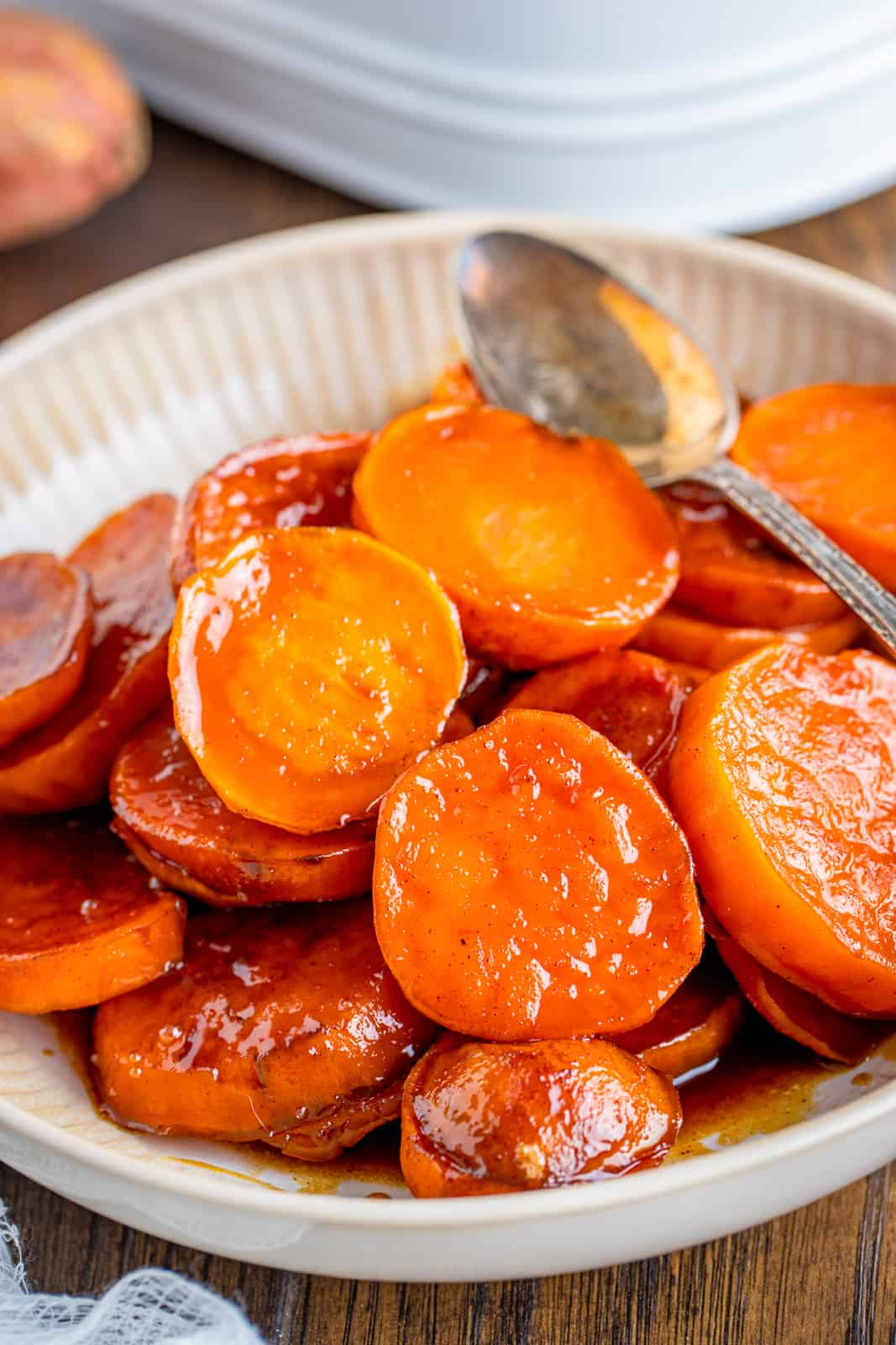 Bowl of Candied Sweet Potatoes with spoon