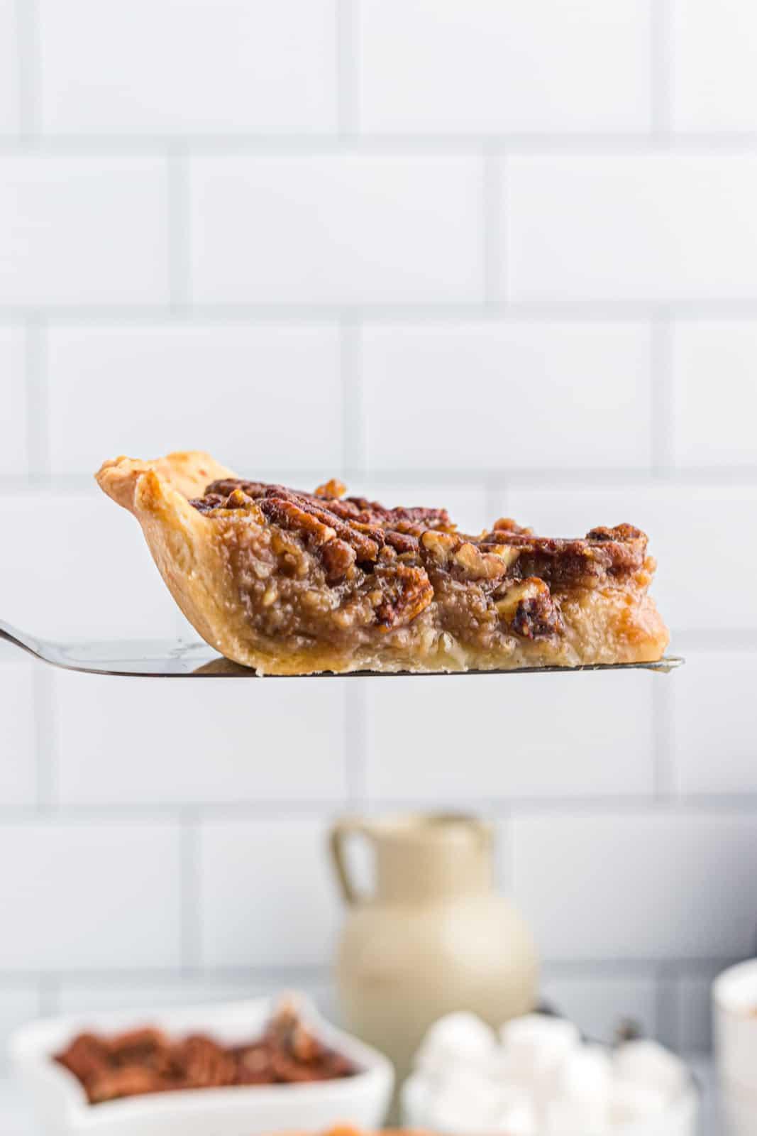 Pie server holding up slice of pie