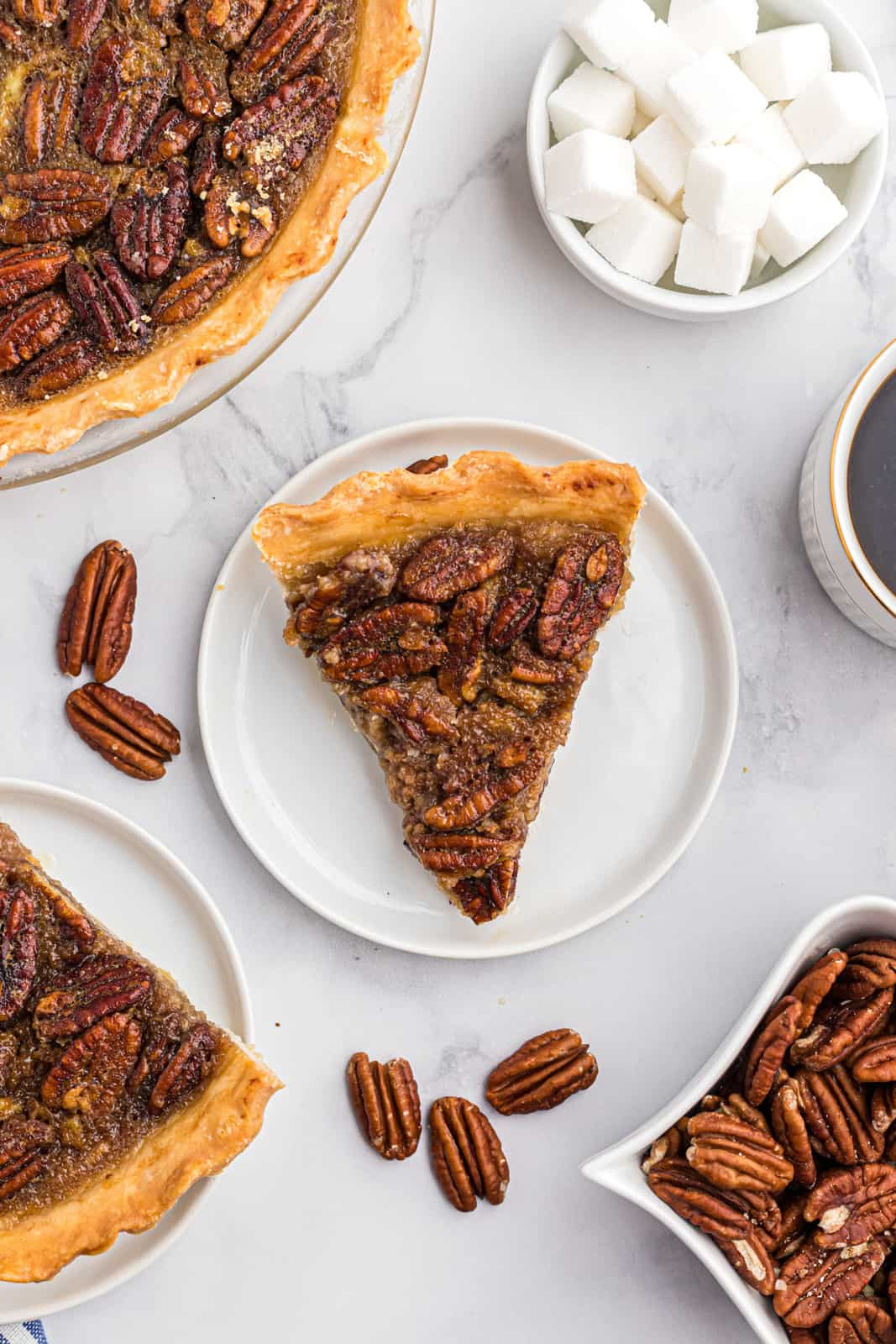Overhead slice of Bourbon Pecan Pie on white plate