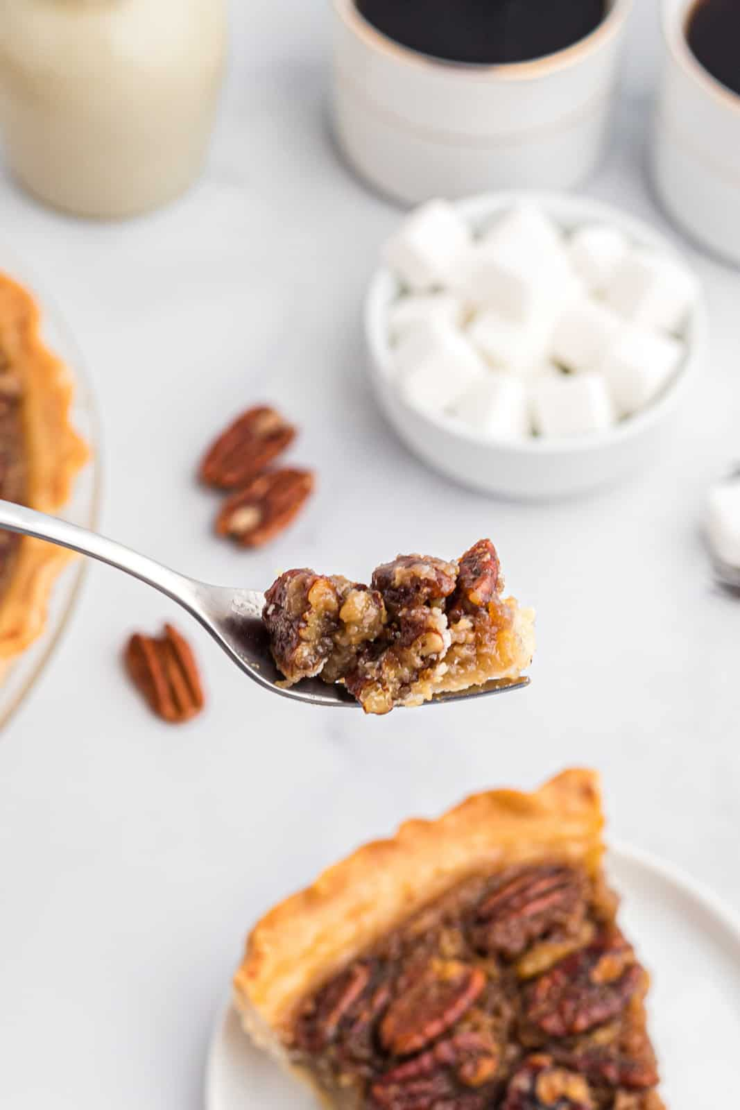 Fork holding up a bite of Bourbon Pecan Pie