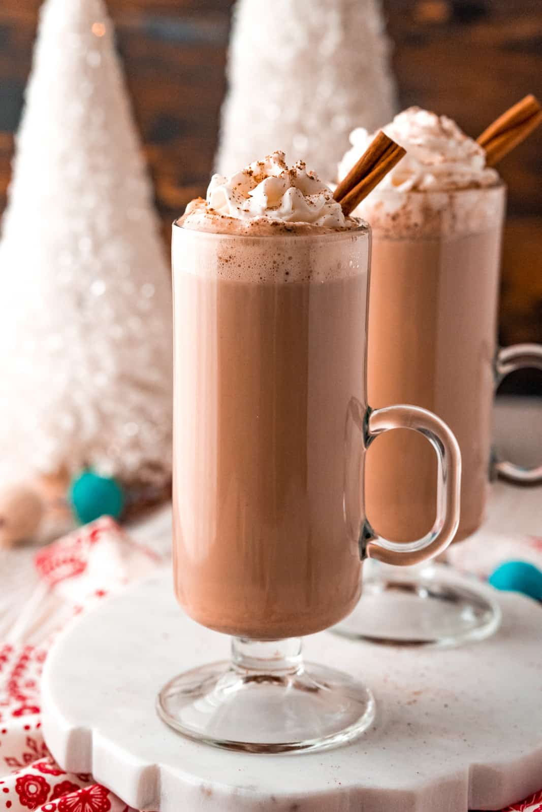 Two glasses of Eggnog Hot Chocolate on white platter