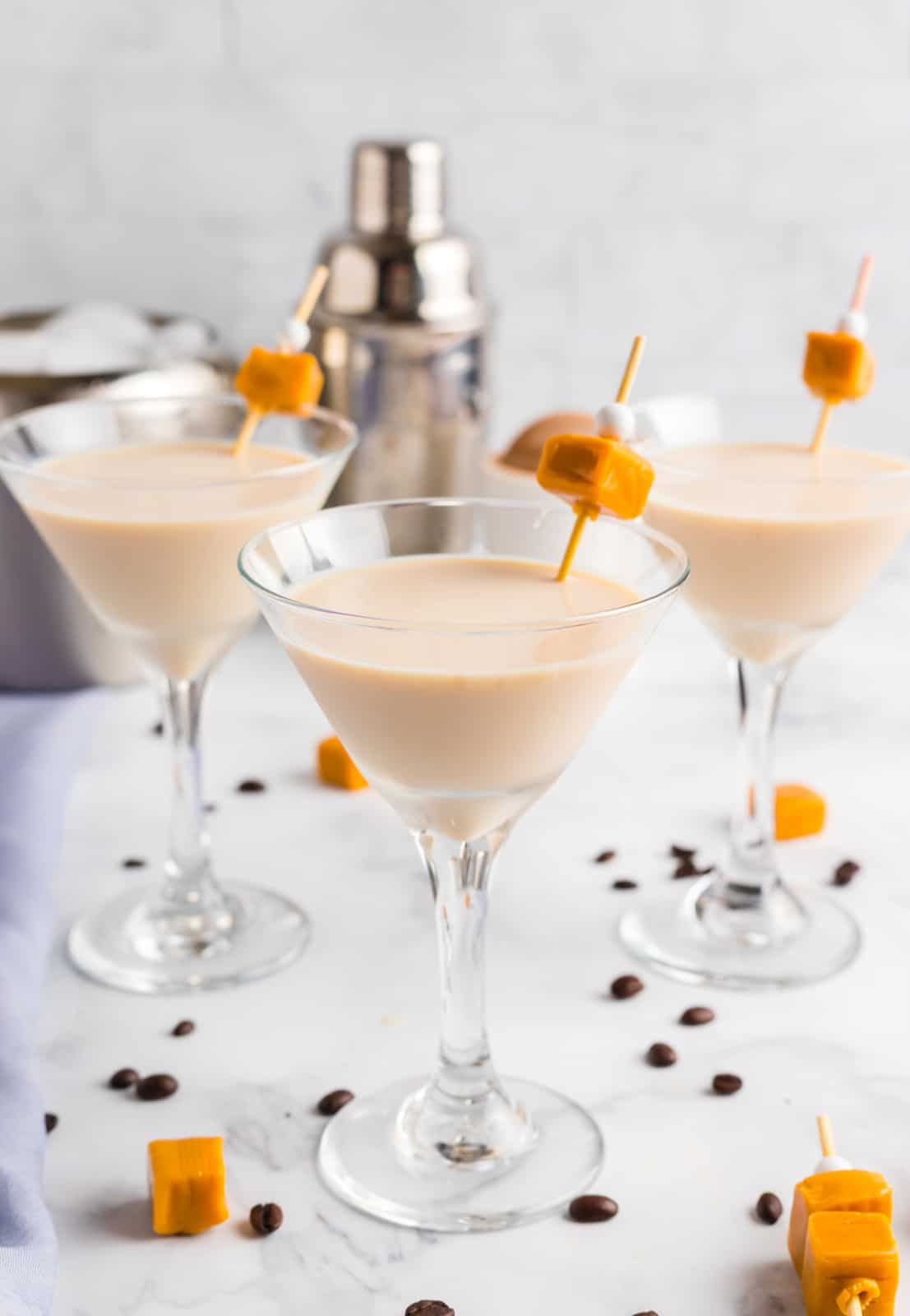 Three Espresso Martinis garnished with caramels