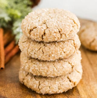 Four stacked Spice Cookies on wooden platter