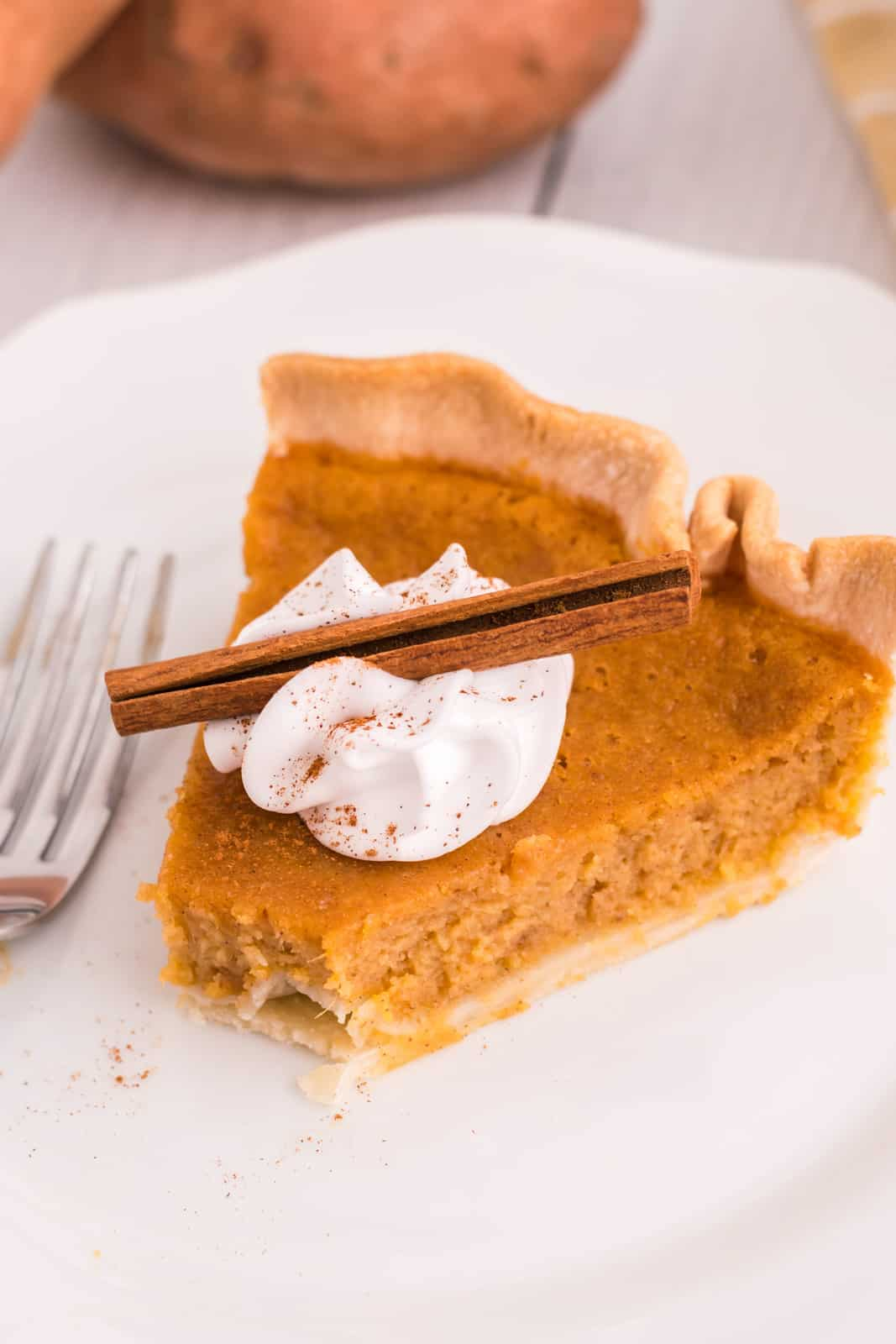 Sweet Potato Pie recipe on plate with bite taken out