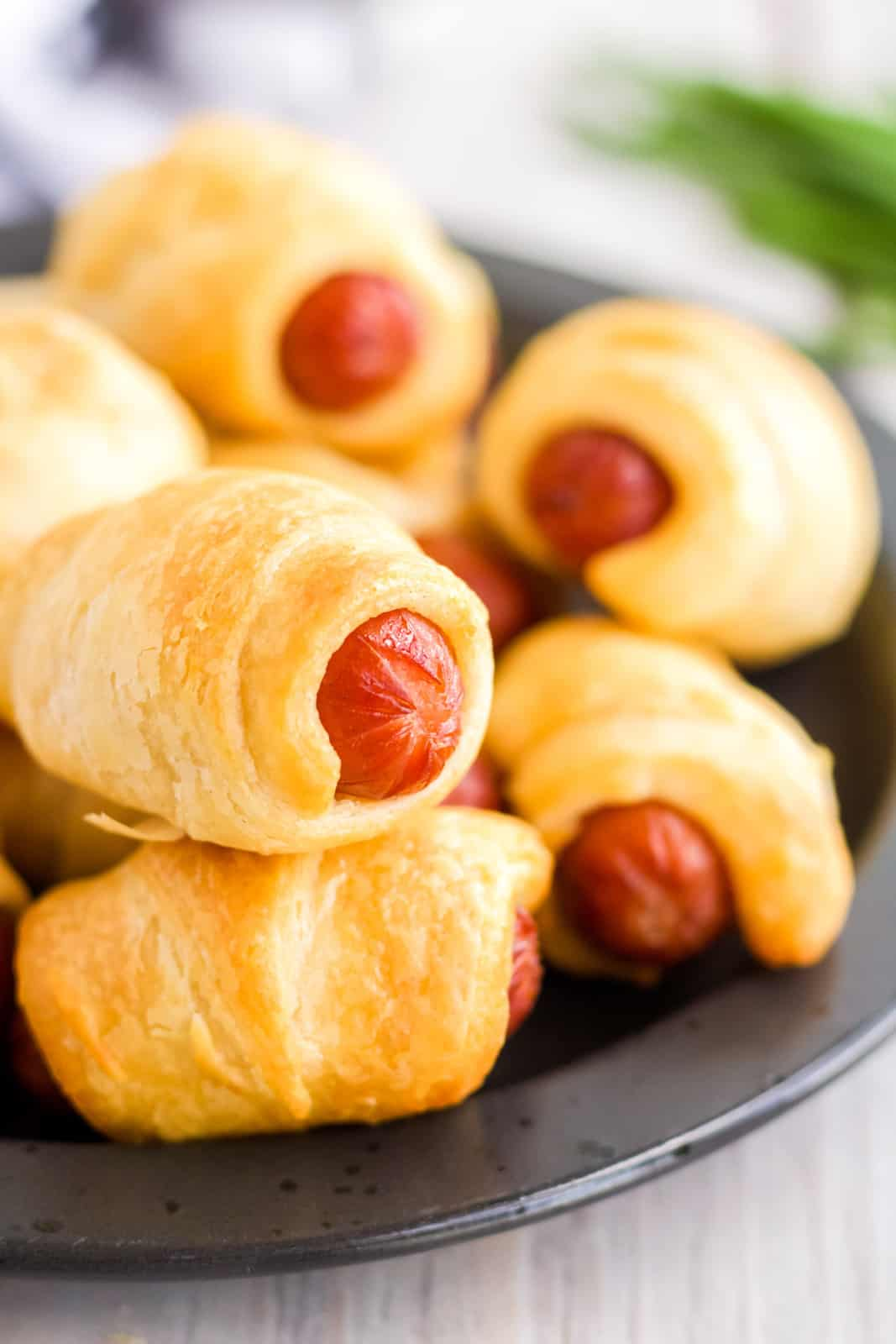Close up of Air Fryer Pigs in a Blanket on black plate