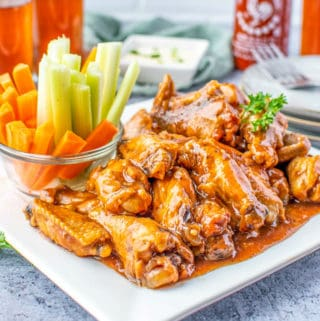 Slow Cooker Chicken Wings on white plate square image