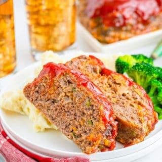 Cracker Barrel Meatloaf slices over mashed potatoes on white plate