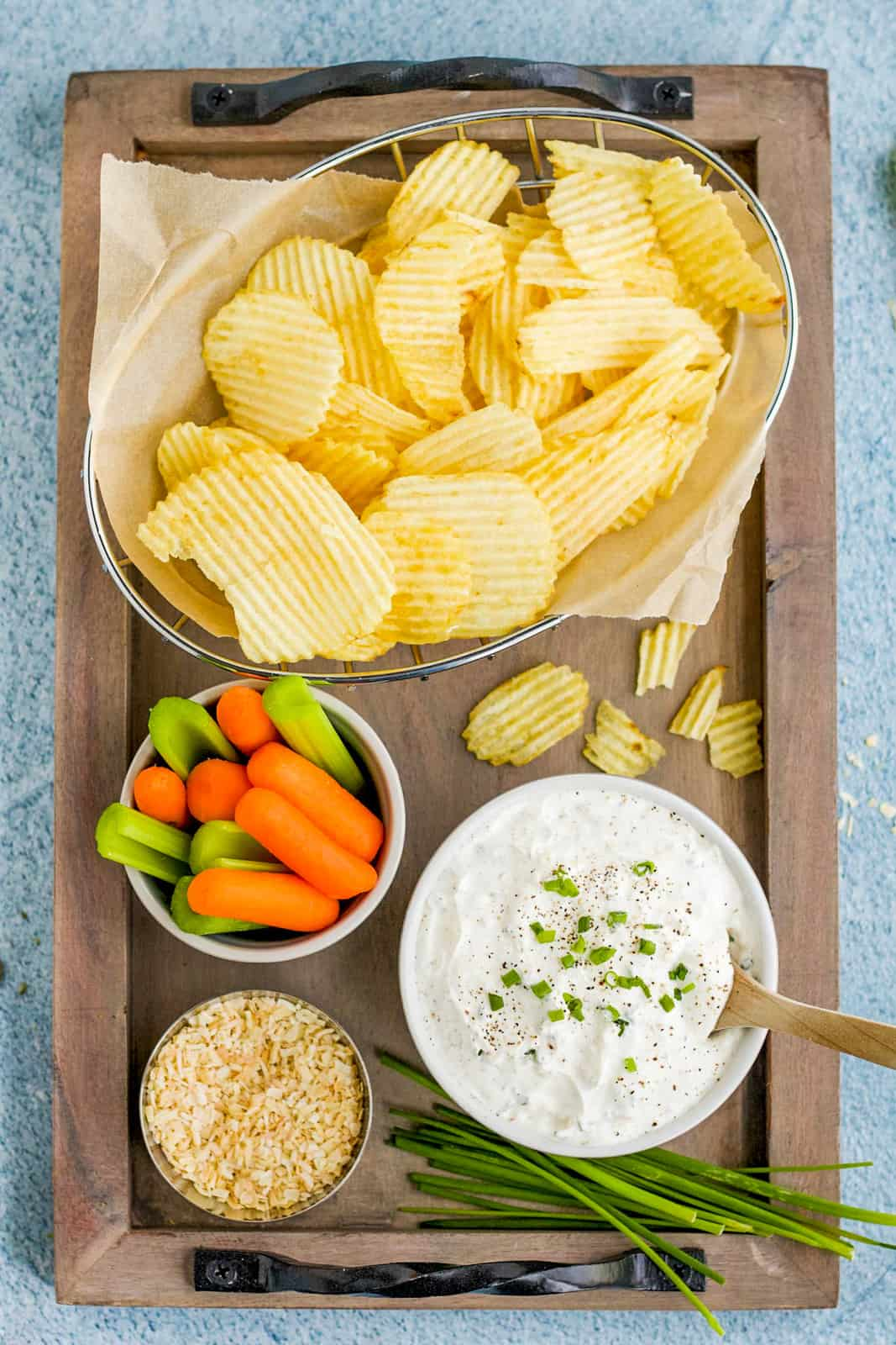 Serving platter with chips, vegetables and French Onion Dip