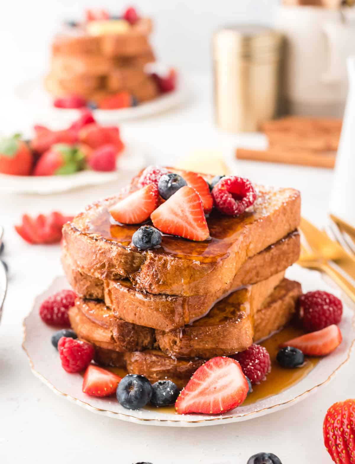 Stack of French Toast With berries and syrup