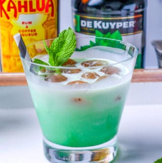 One Glass of a Thin Mint White Russian Recipe garnished with a mint leaf