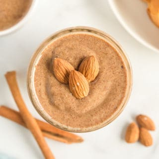 Overhead of Almond Butter in jar topped with almonds