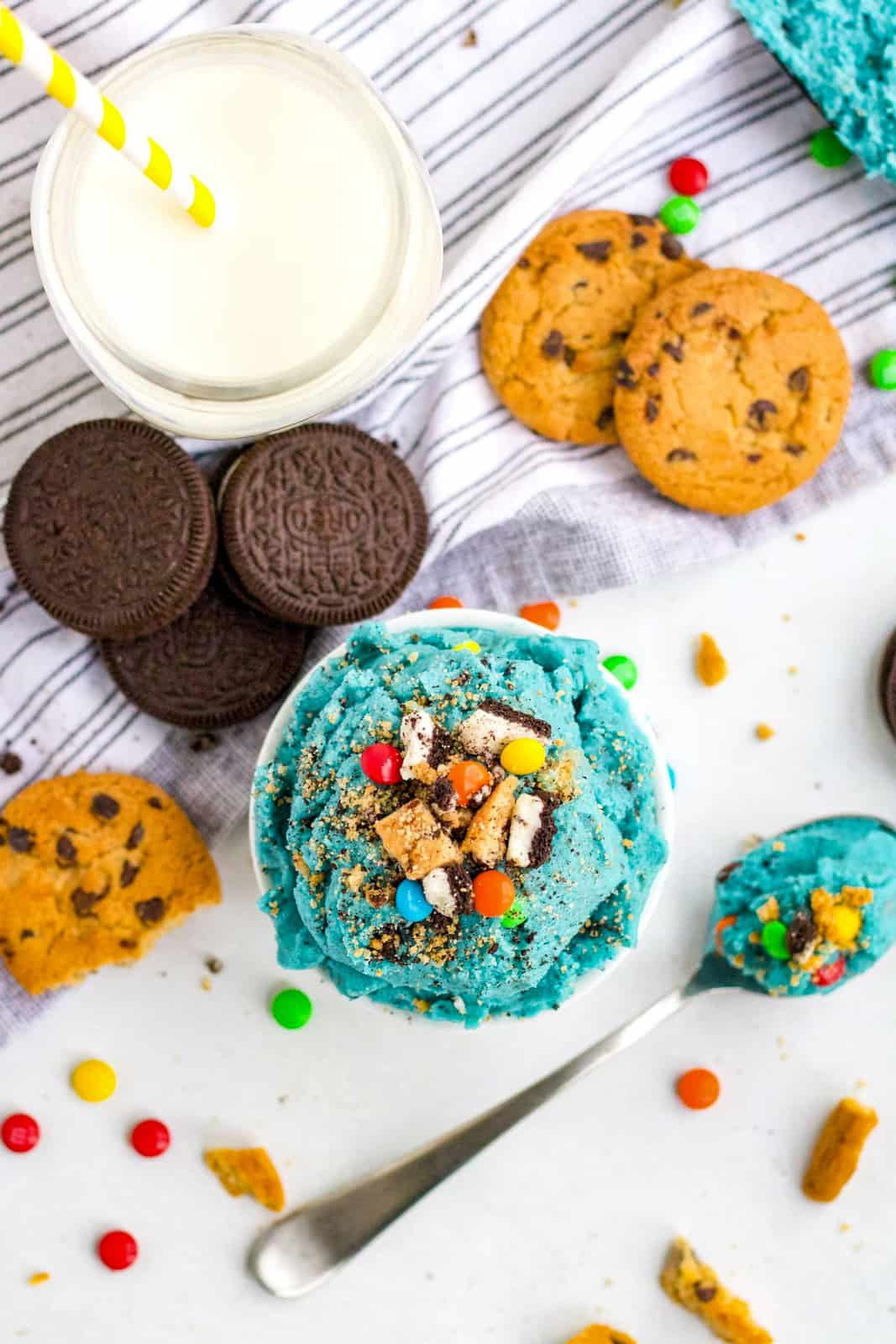 Overhead of cookie dough in bowl with cookies surrounding it