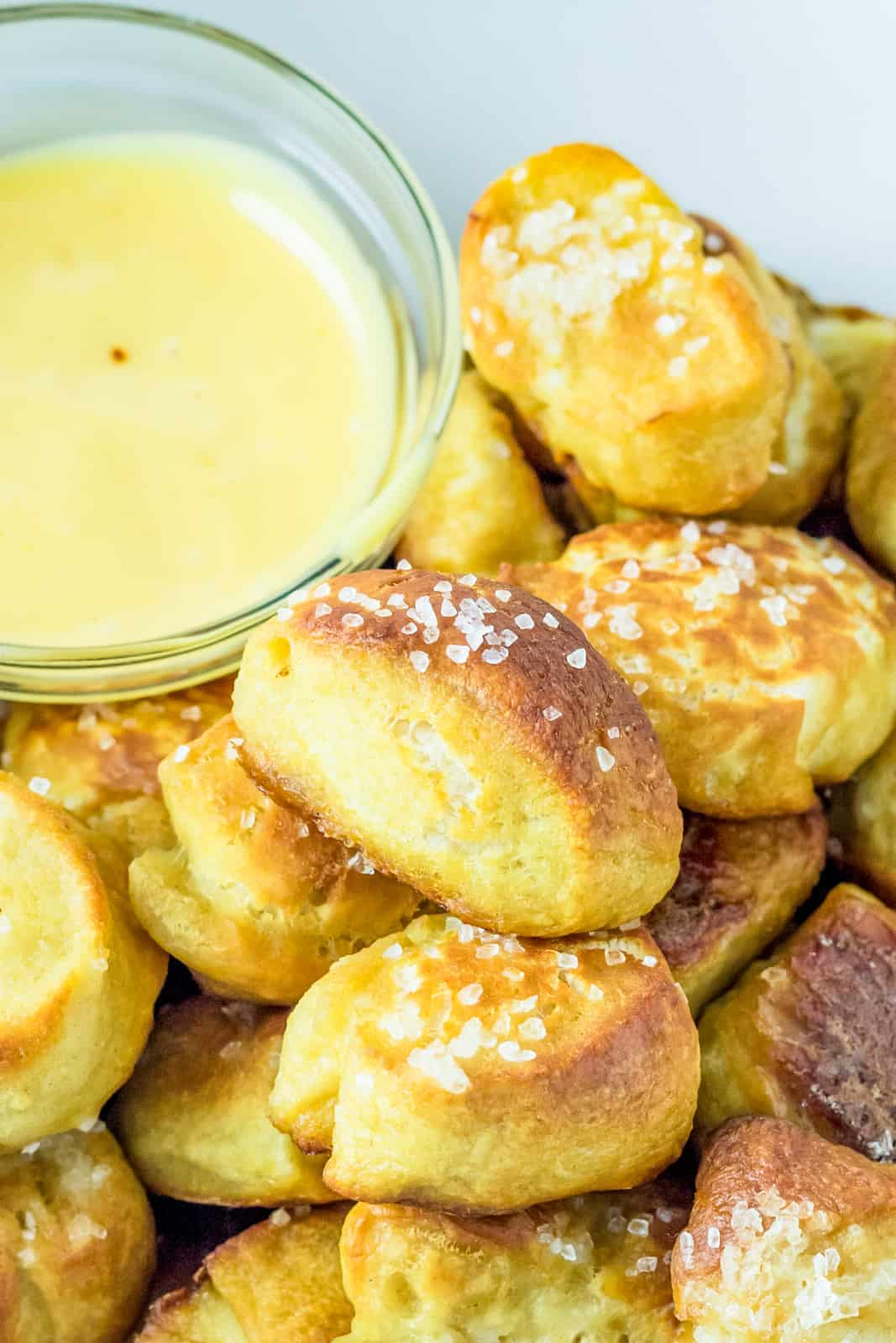 Stacked Pretzel Bites in basket with cheese sauce