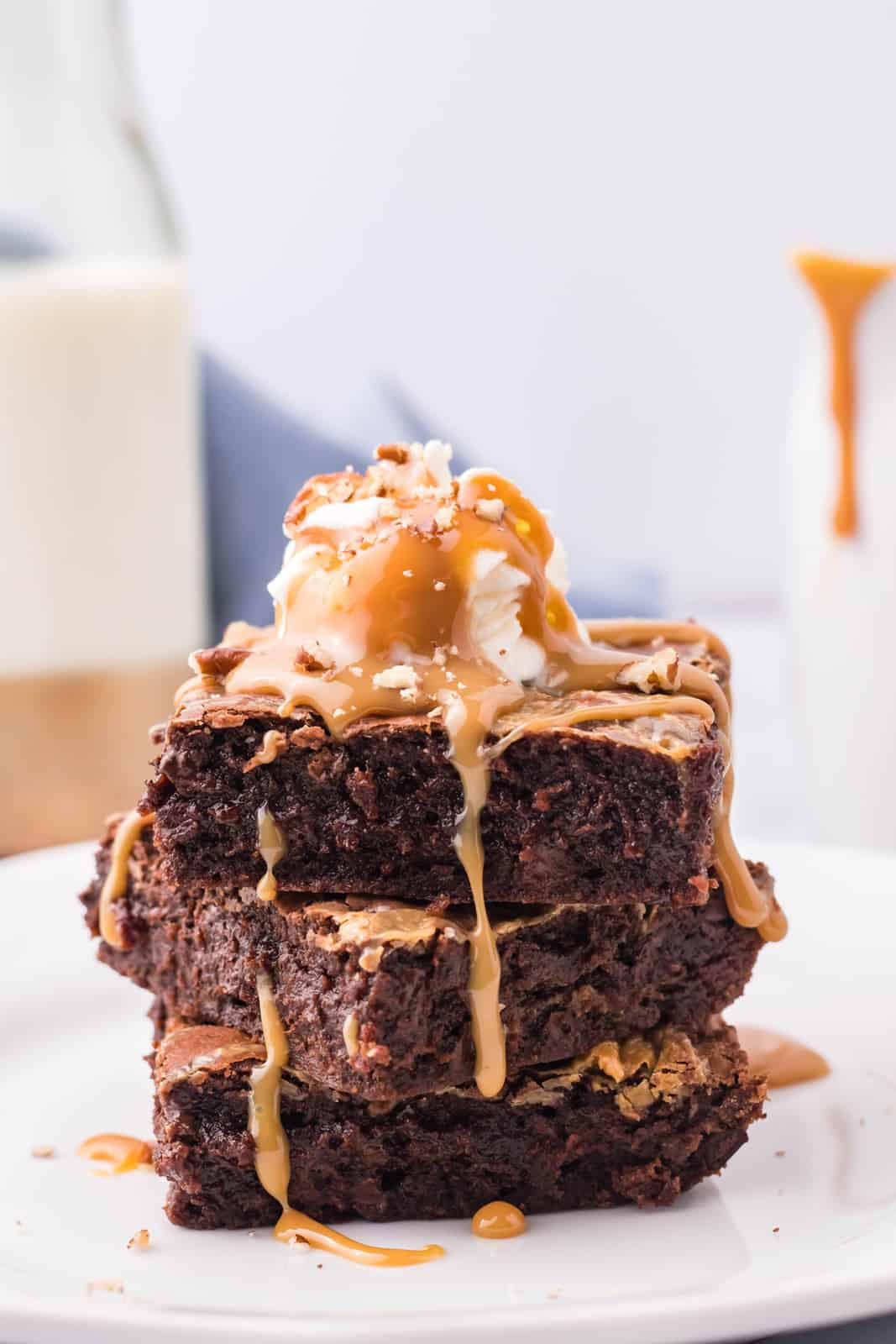 Three stacked Caramel Brownies drizzled with caramel