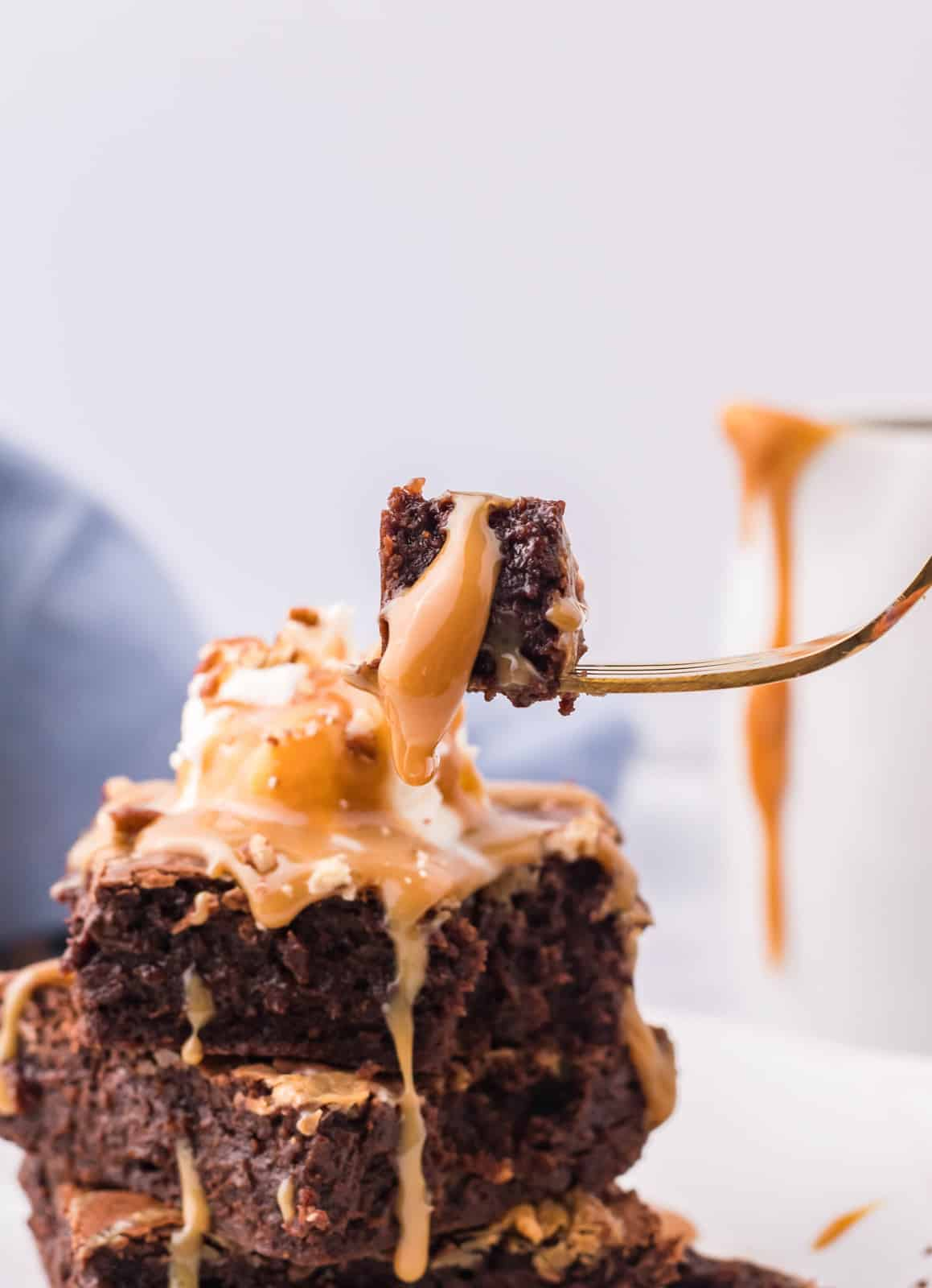 Fork lifting a bite out of Caramel Brownies