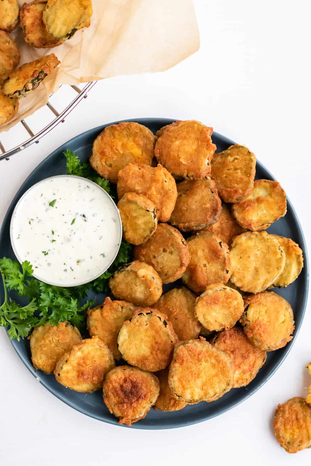 Overhead image of Fried Pickles on plate with ranch