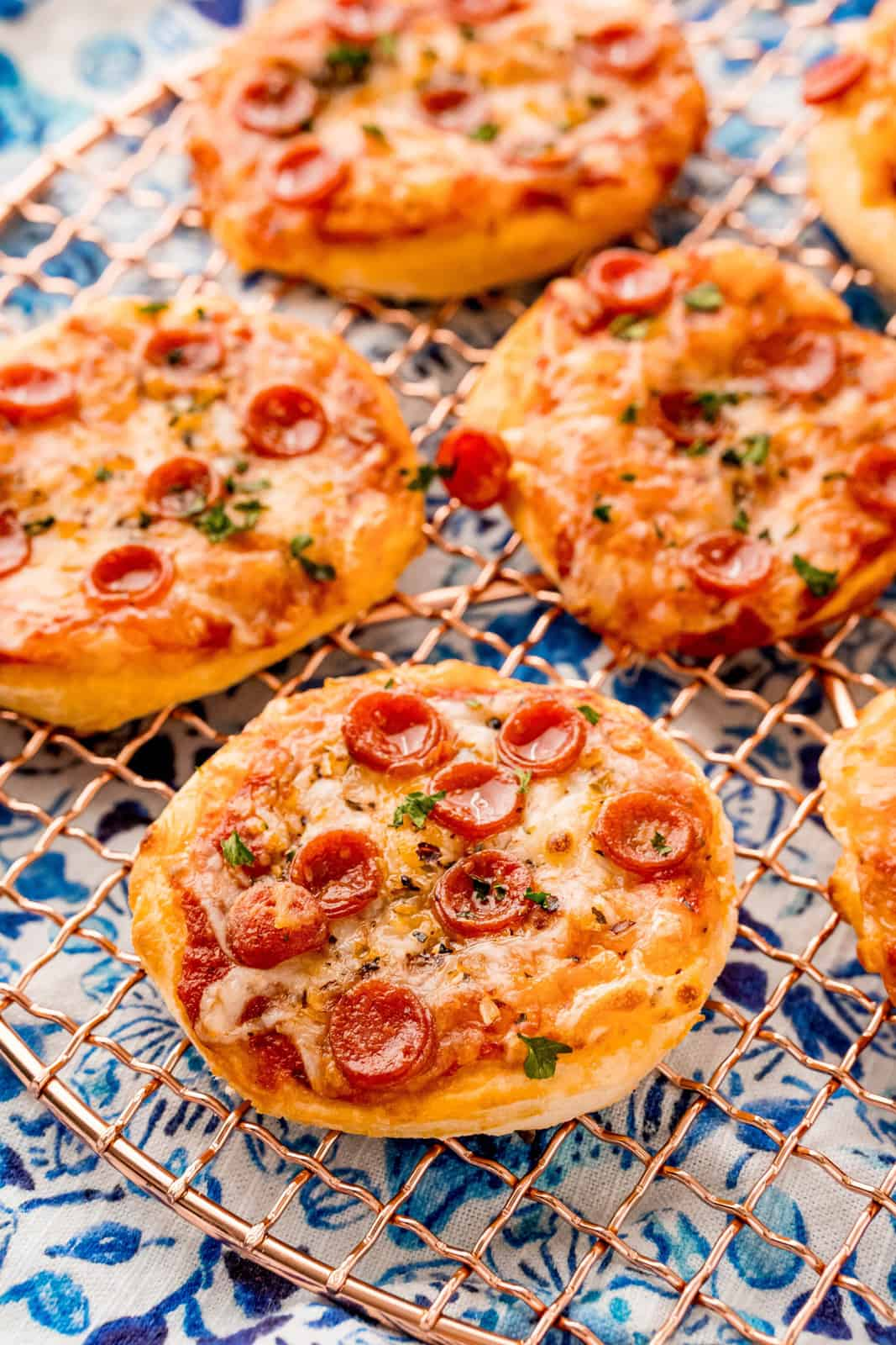 Air Fryer Pizzas on round wire rack
