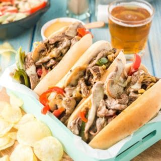 Philly Cheesesteak Recipe in tray with potato chips on side