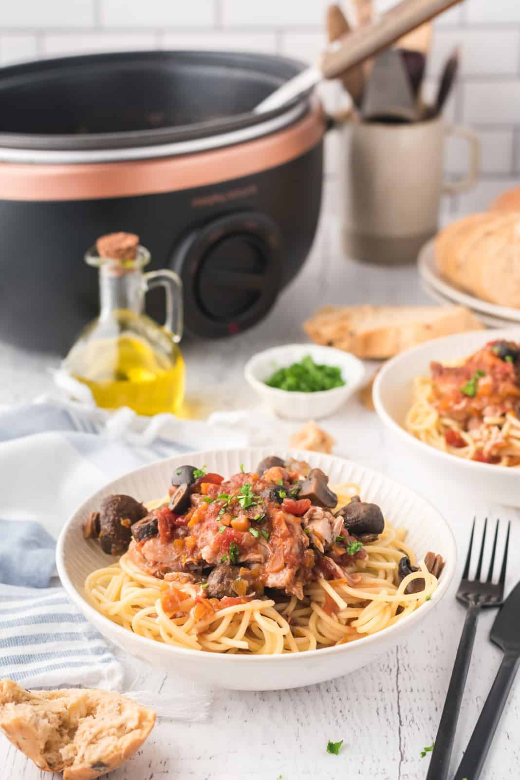 Slow Cooker Chicken Cacciatore over pasta in white bowl
