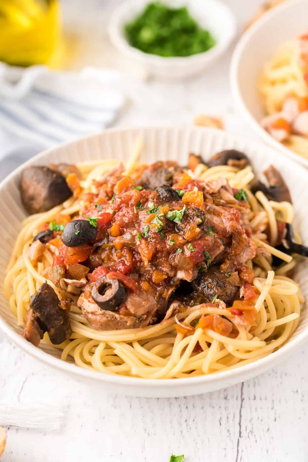 Close up of served Slow Cooke Chicken Cacciatore over spaghetti