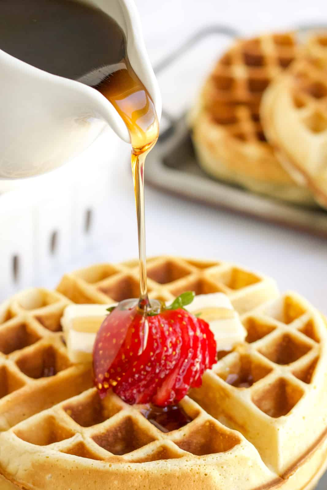 Syrup being poured over Belgian Waffle Recipe