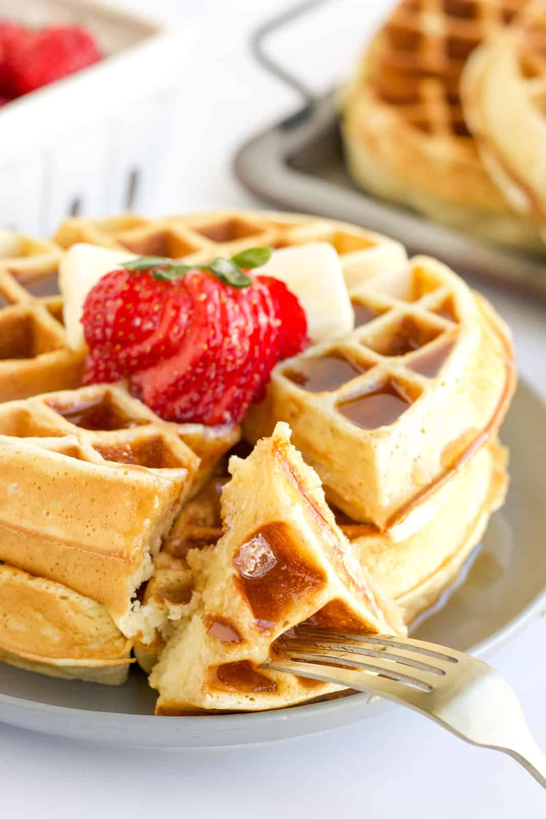 Close up of Belgian Waffle Recipe with fork holding two slices