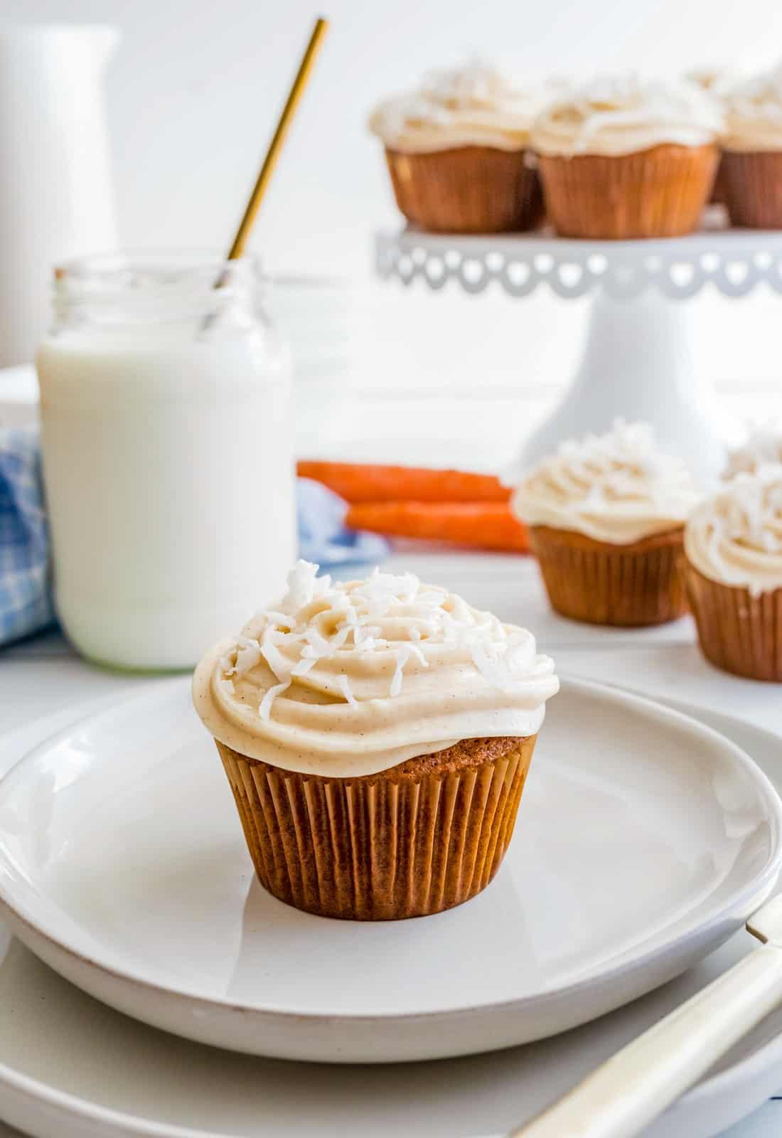 Single cupcake on white plate