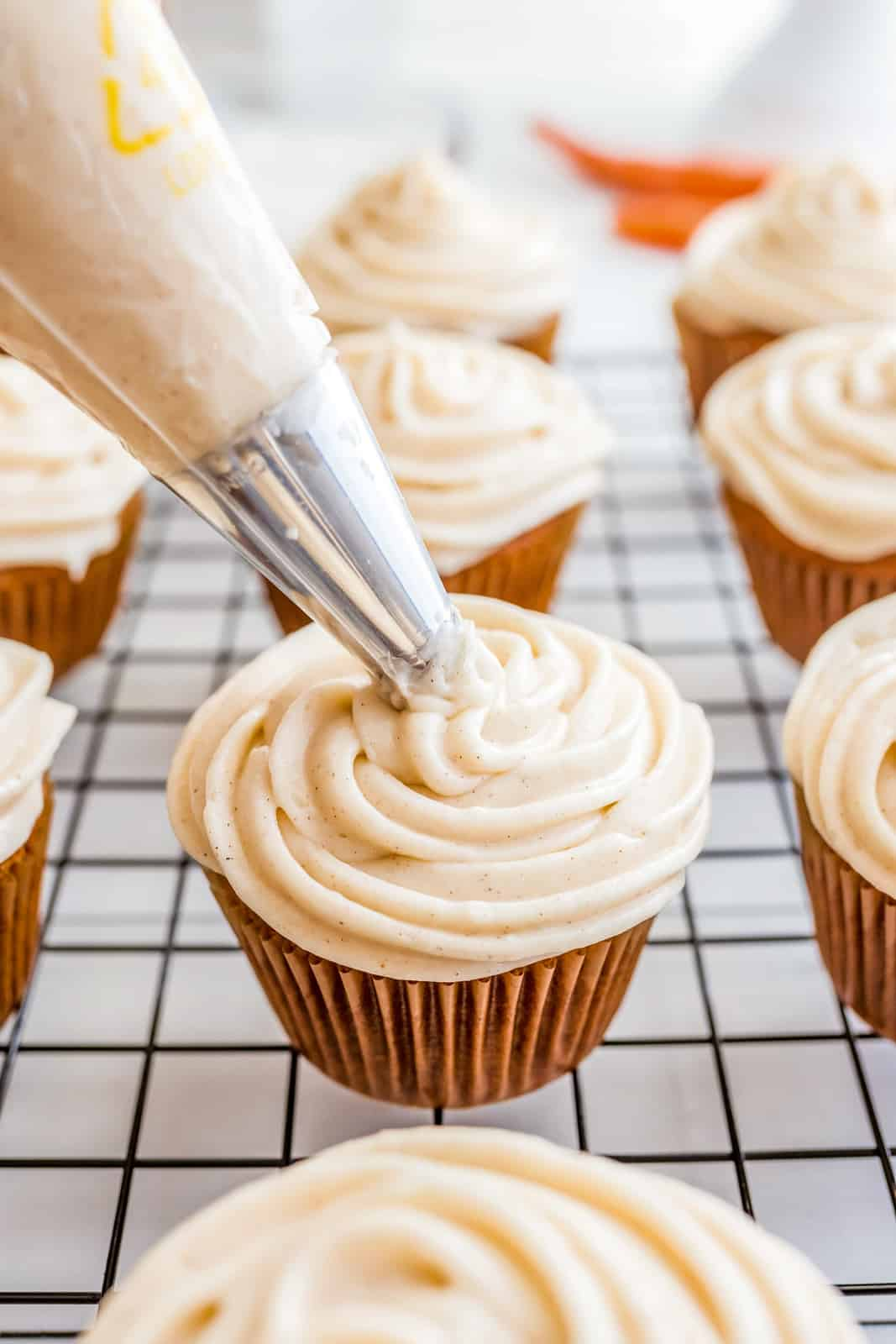Carrot Cake Cupcakes being frosted