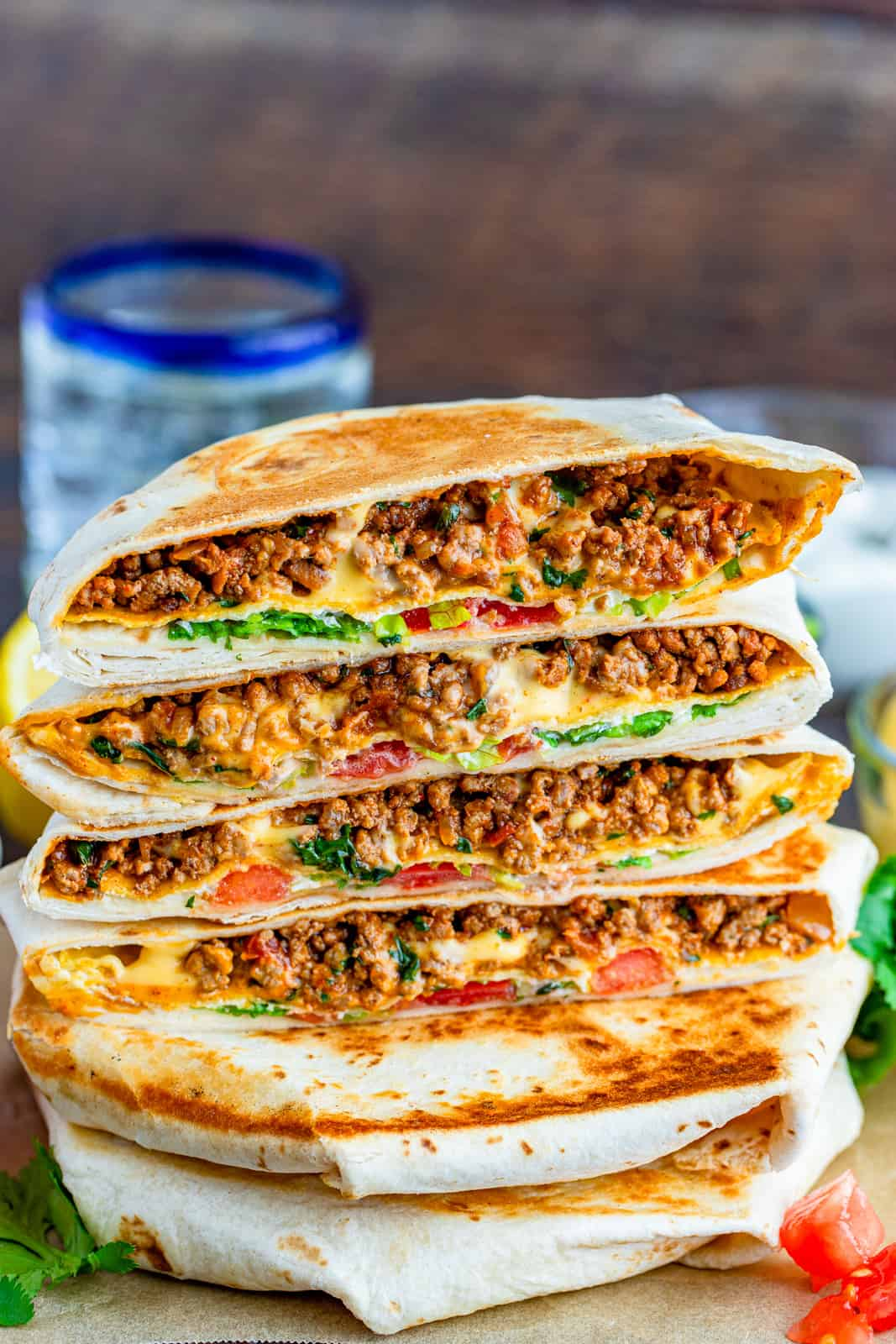 Stacked Crunchwrap Supremes on top of one another cut in half