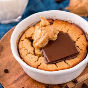 White bowl with Baked Oats topped with peanut butter and chocolate square image
