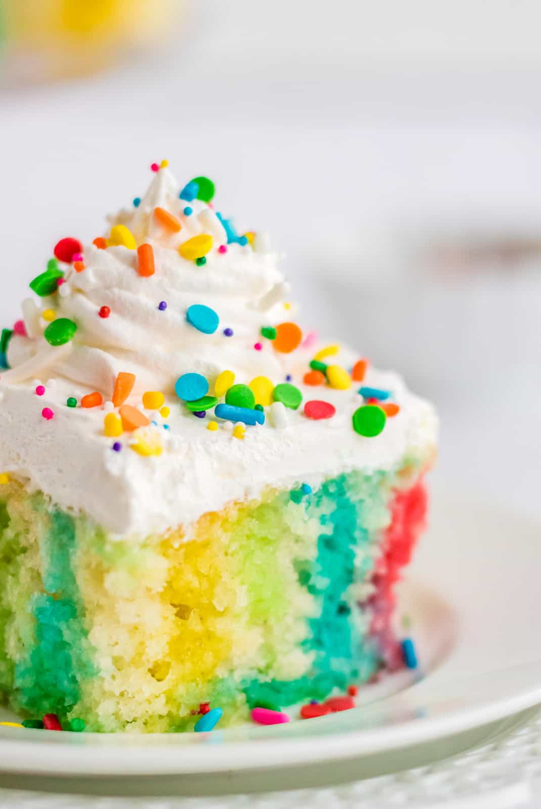 Close up side view of Jello Poke Cake showing colors