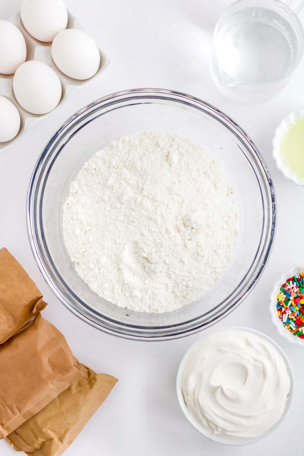 Ingredients needed to make a Rainbow Jello Poke Cake