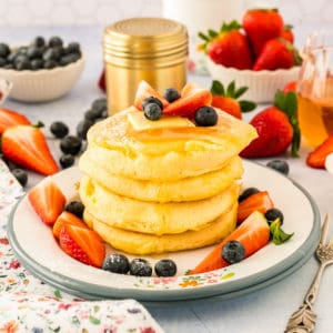 Close up of pancakes on plate stacked square image