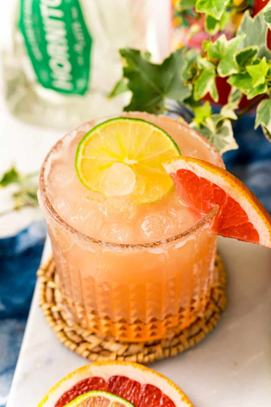 Overhead of a Paloma Cocktail garnished with lime and grapefruit