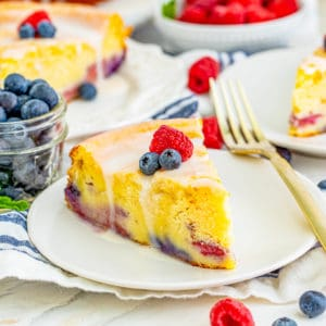 Close up square image of Ricotta Cake on white cake with berries