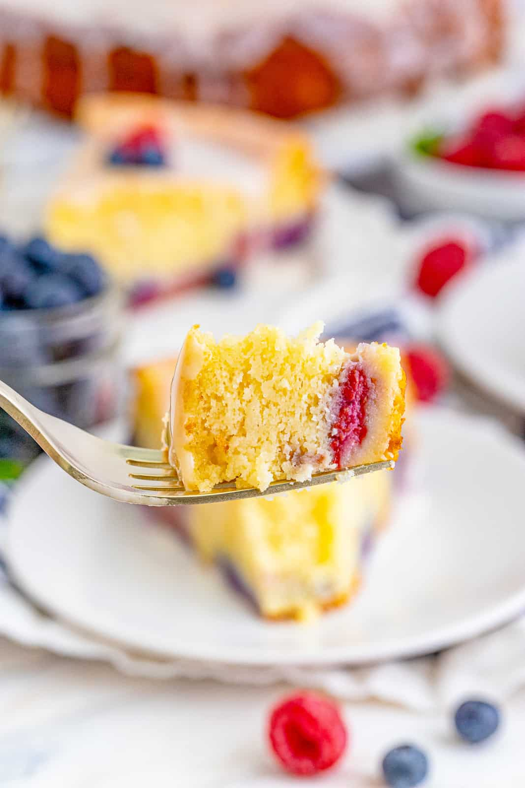 Fork holding up a piece bite of cake on fork