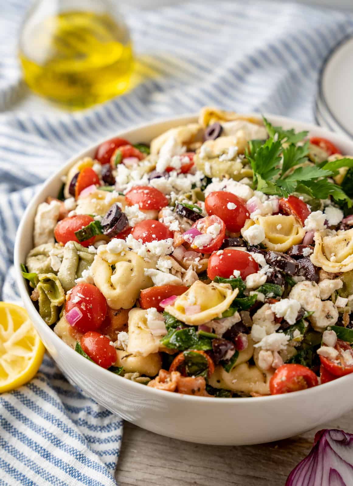 Greek Pasta Salad in white serving bowl