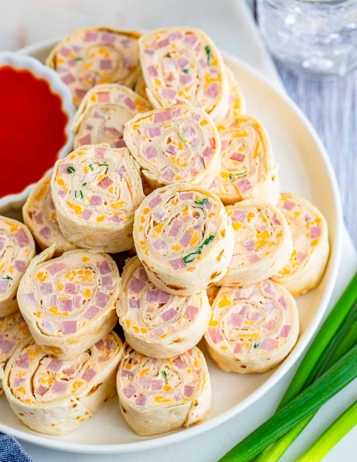 Overhead of stacked Mississippi Sin Dip Pinwheels on white plate