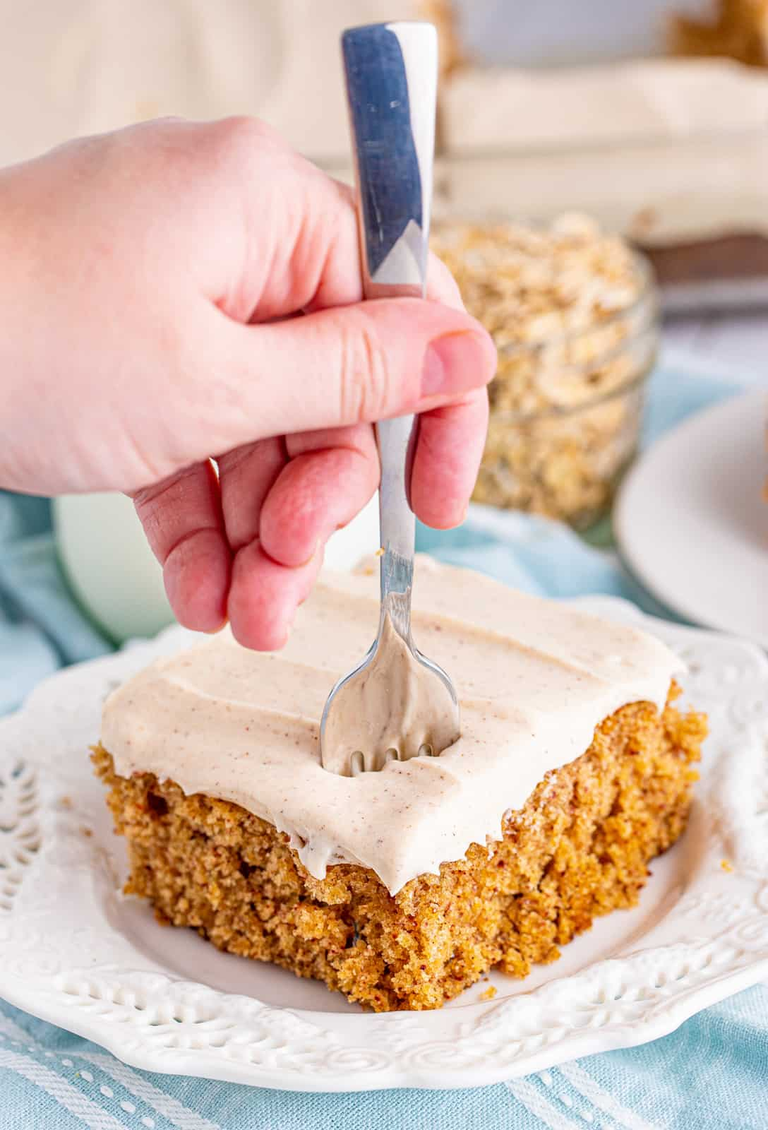 Fork going into Oatmeal Cake on white plate