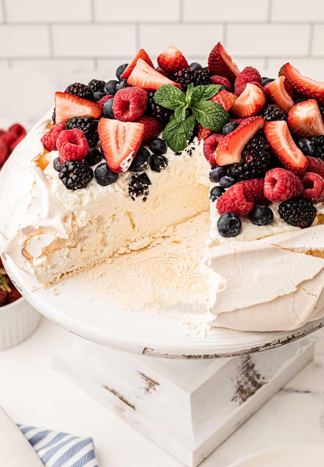Slice missing from Pavlova recipe on cake stand