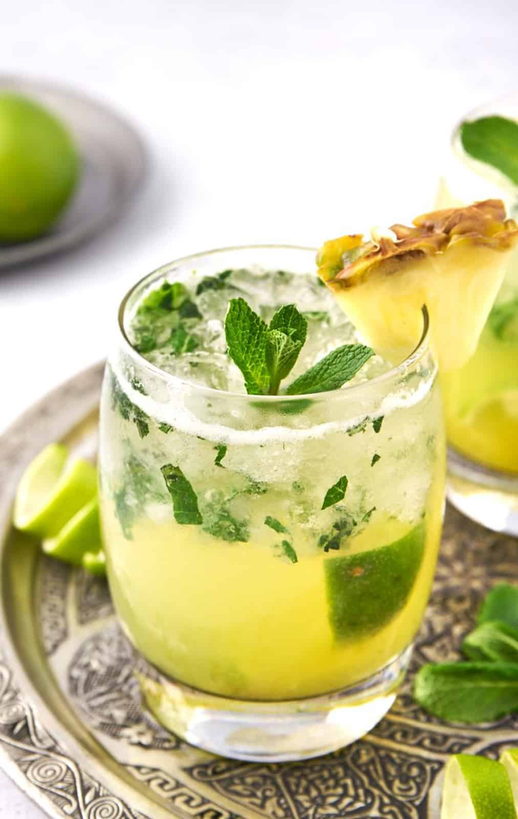 Close up of one glass of a Pineapple Mojito on silver platter