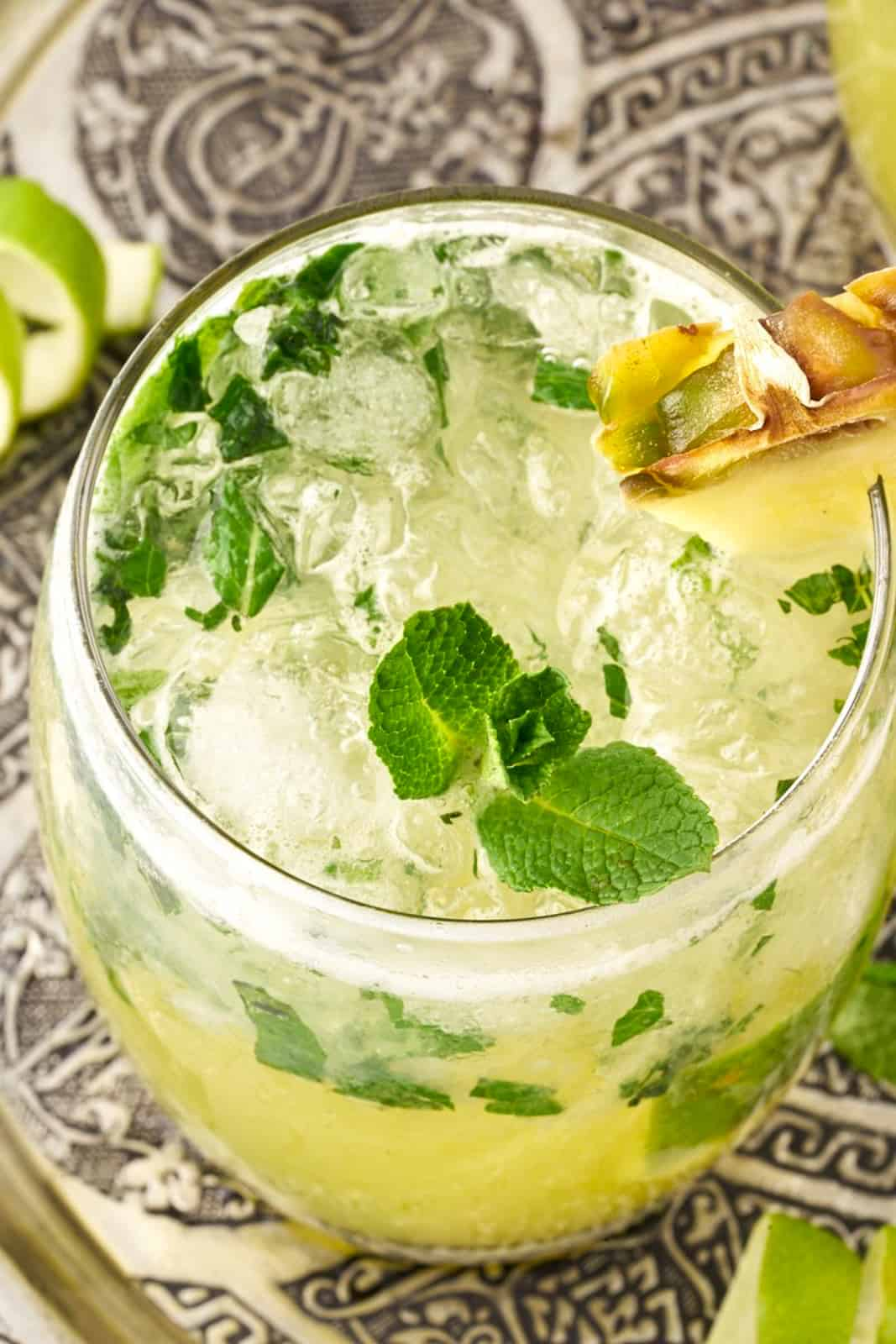 Overhead of one mojito in glass showing mint